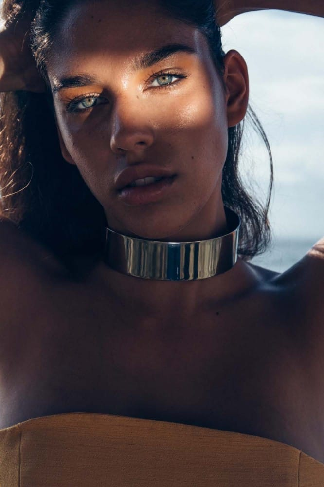 Balistarz-model-Samantha-Garza-portrait-shoot-with-a-top-and-a-large-silver-metal-collar-with-the-beach-in-the-background