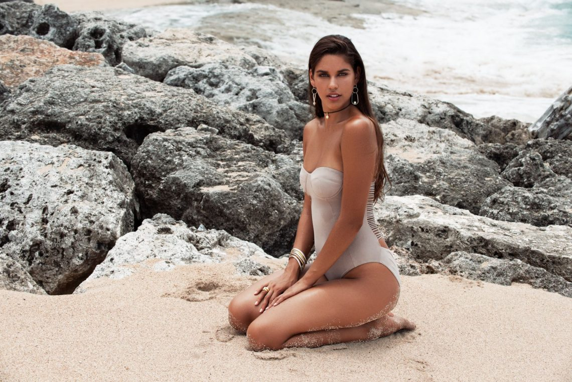 Balistarz-model-Samantha-Garza-landscape-beach-shoot-for-Fairley-sitting-on-the-sand-in-a-white-swimsuit