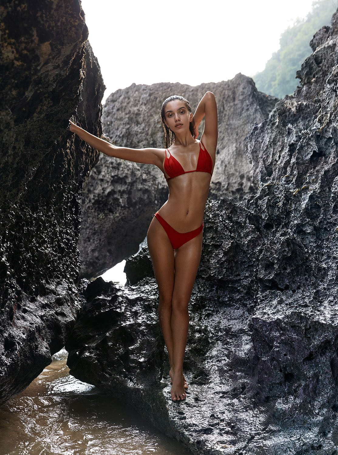 Balistarz-model-Sasha-AP-red-bikini-shot-betwen-sea-rocks