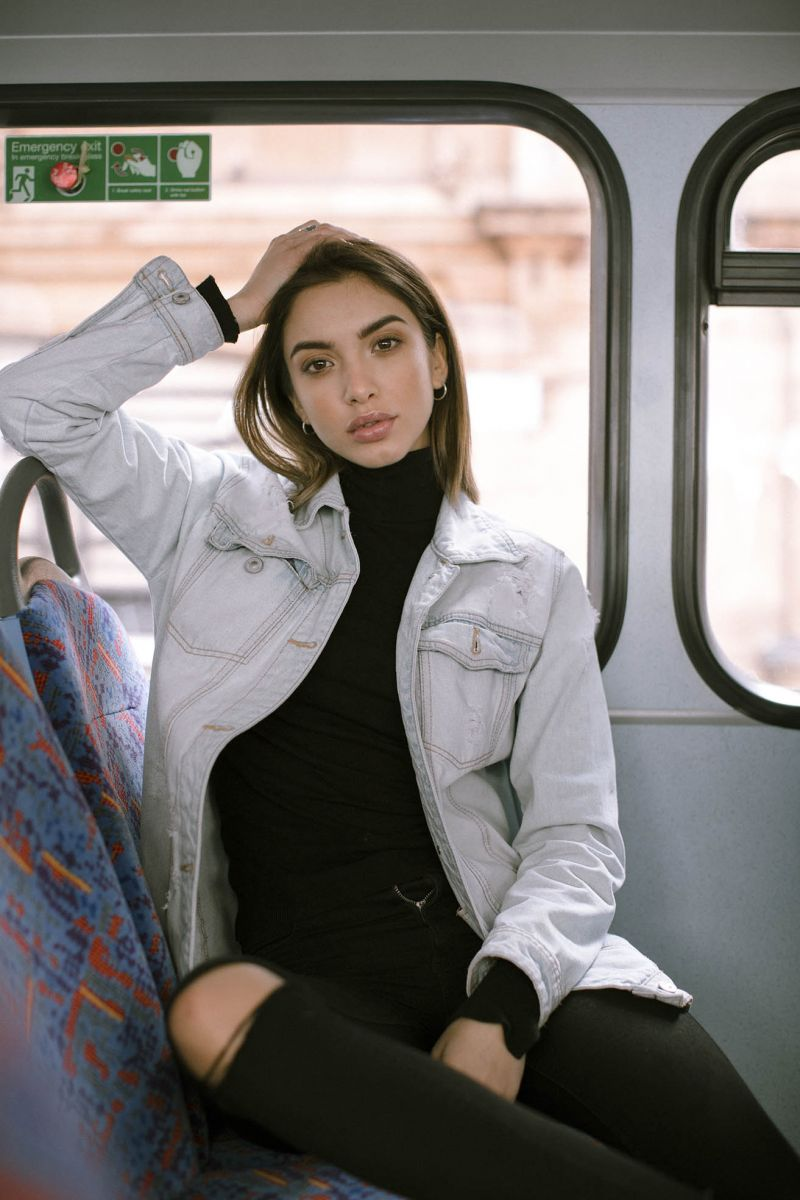 Balistarz-model-Sasha-AP-doing-a-portrait-session-inside-a-city-bus-wearing-blue-jeans-jacket