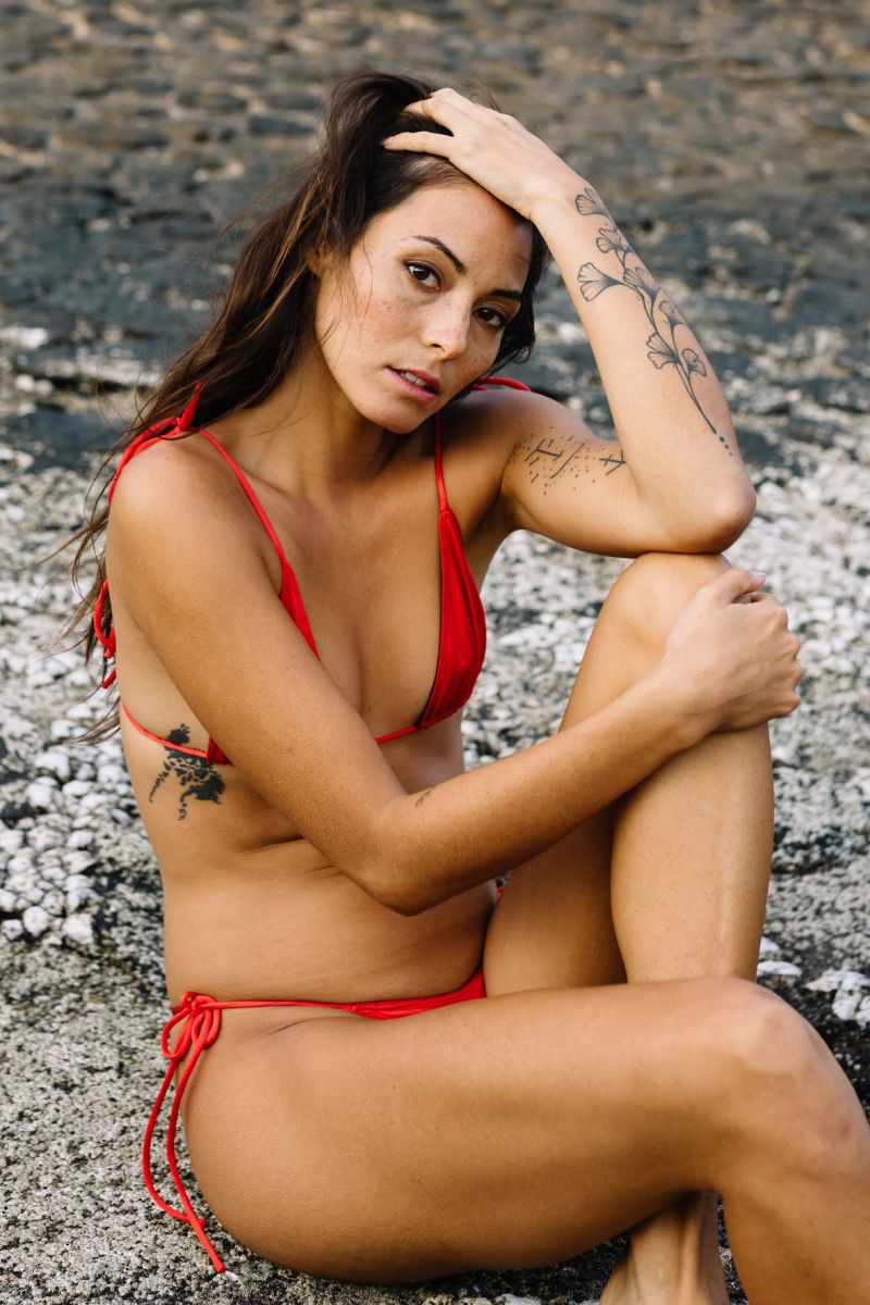 Balistarz-model-Stephanie-Baier-portrait-beach-shoot-relaxing-in-a-red-bikini