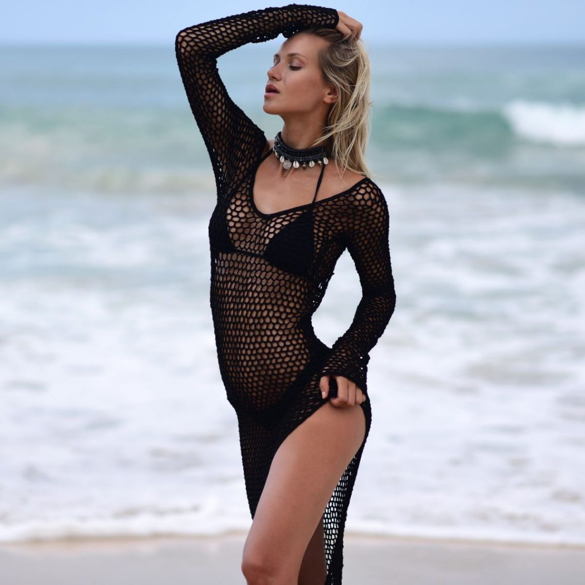 Balistarz-model-Sylvia-Koronkiewicz-standing-by-the-sea-in-her-sexy-beach-suit