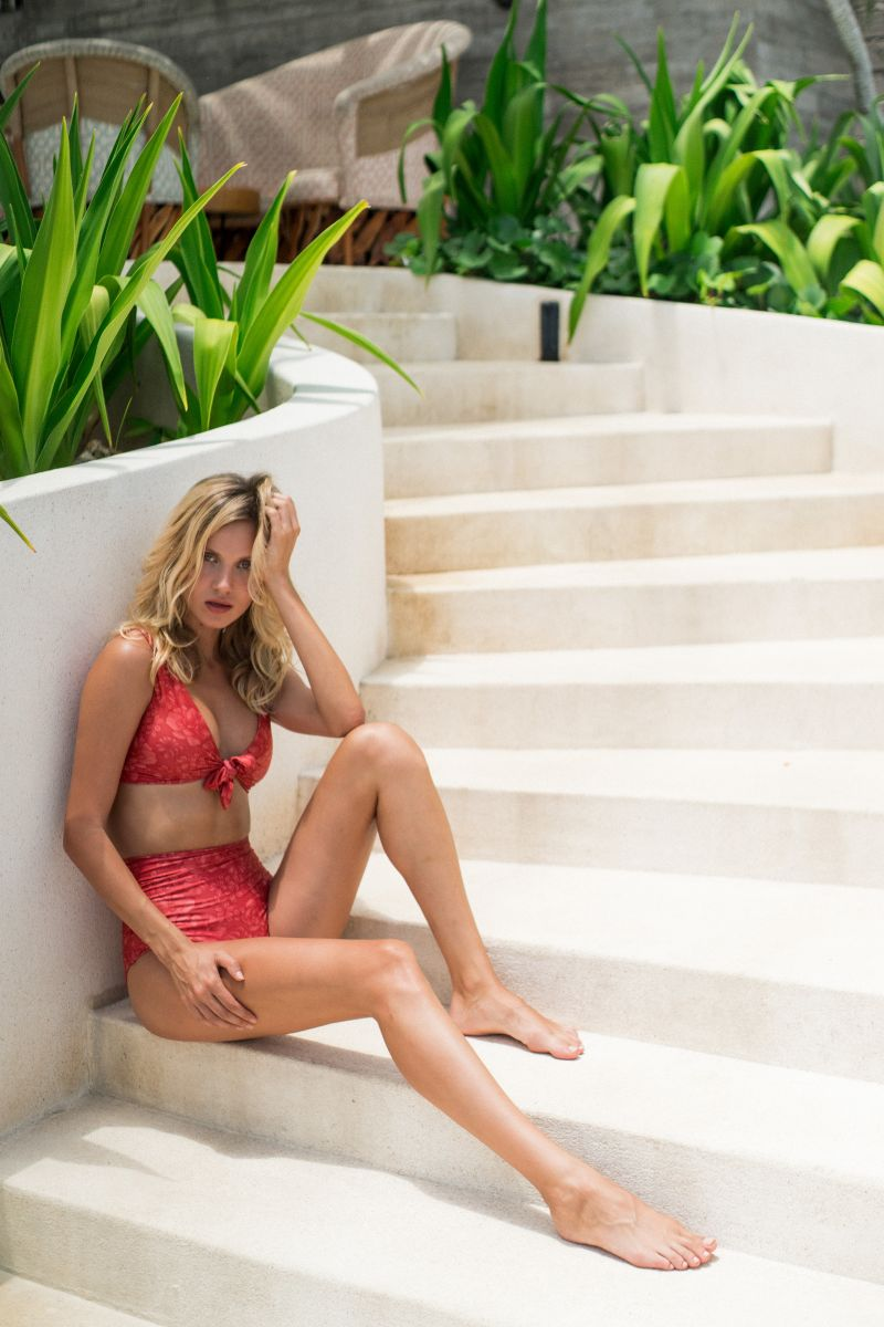 Balistarz-model-Sylvia-Koronkiewicz-sitting-at-the-side=of-the-stairway-wearing-her-red-swim-suit