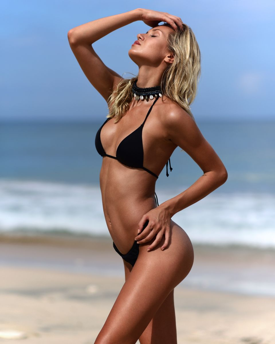 Balistarz-model-Sylvia-Koronkiewicz-standing-against-the-sun-in-black-bikinis