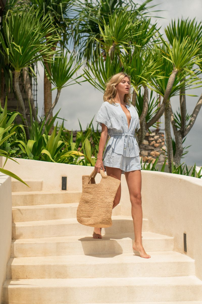 Balistarz-model-Sylvia-Koronkiewicz-stepping-trough-the-stairways-wearing-casual-beach-wear-and-sustainable-bag
