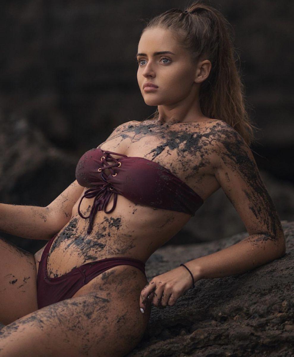 Balistarz-model-Tanusha-Tatiana-Mishenka-portrait-shoot-in-red-swimwear-covered-in-mud