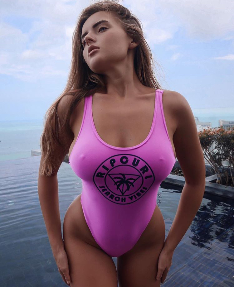 Balistarz-model-Tanusha-Tatiana-Mishenka-portrait-shoot-in-a-pink-tankini-standing-in-a-pool