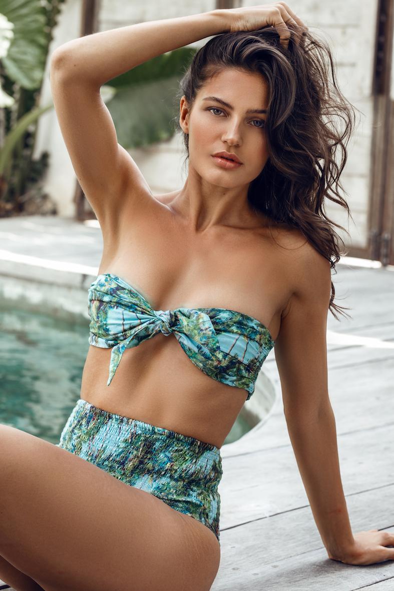 Balistarz-model-Thea-Bull-portrait-shoot-sitting-on-the-poolside-in-a-blue-swimsuit
