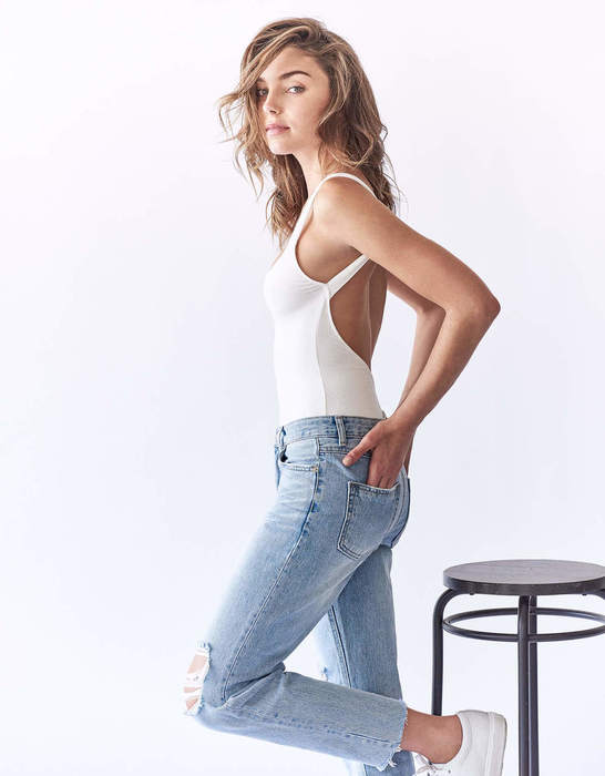 Balistarz-model-Tilly-Jac-Smith-portrait-shoot-with-a-blue-top-jeans-and-a-stool