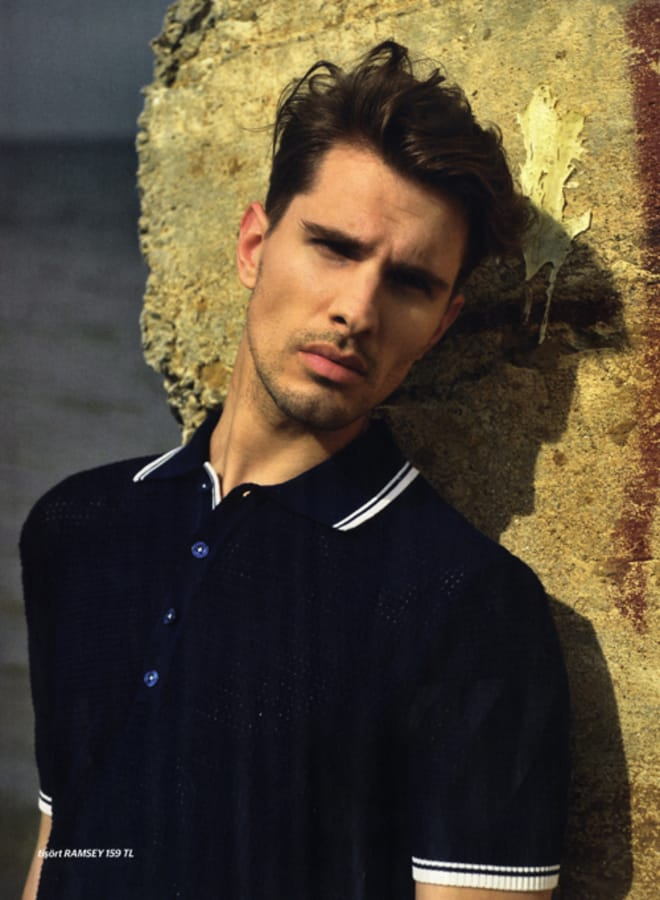 Balistarz-model-Tobi-Klanner-casual-style-wearing-black-polo-shirt-under-great-light