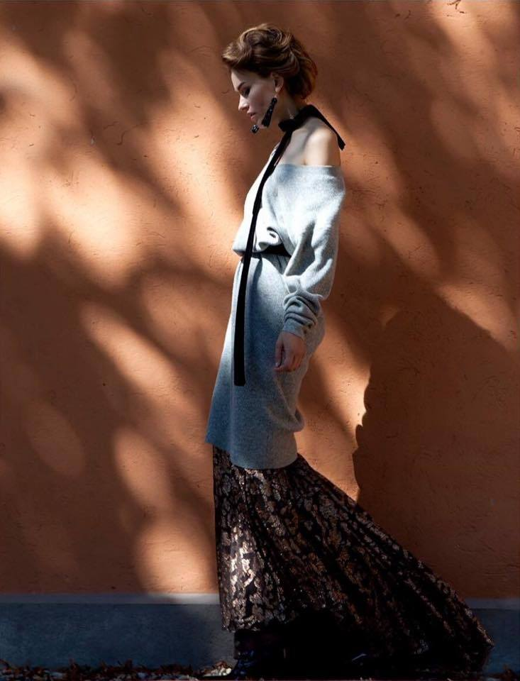 Balistarz-model-Zane-Garlaskelli-fashion-shot-with-long-dress-in-front-of-wall-with-sun-shadow