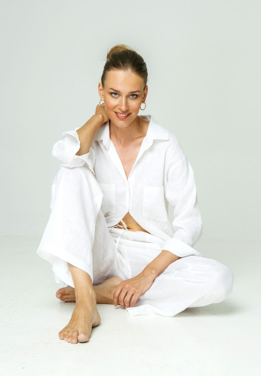Balistarz-model-Zane-Garlaskelli-portrait-taken-in-a-studio-sitting-comfortably-wearing-white-casual-dress