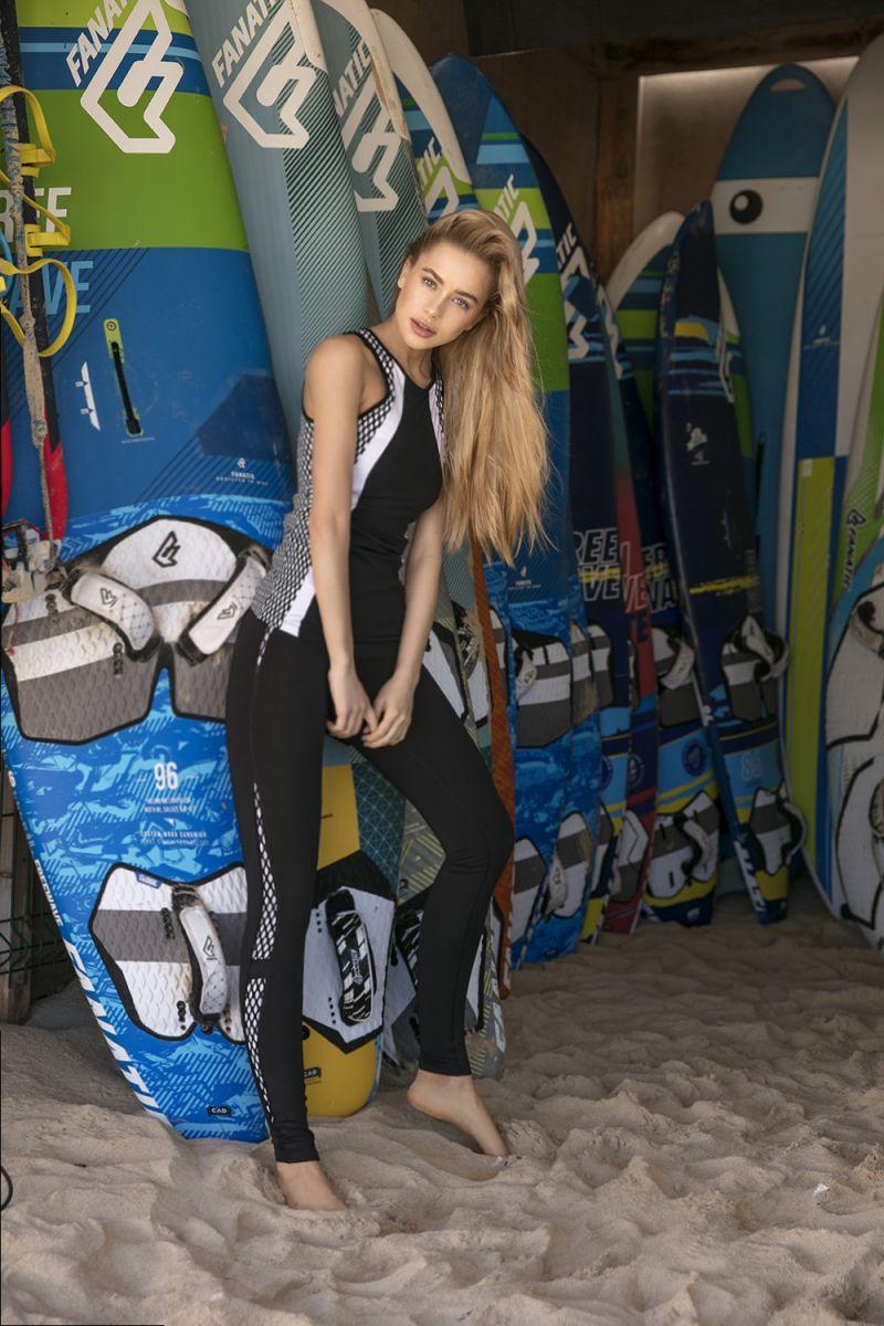 Balistarz-model-Kristina-Gwiazda-wearing-black-wet-suit-near-surfing-boards