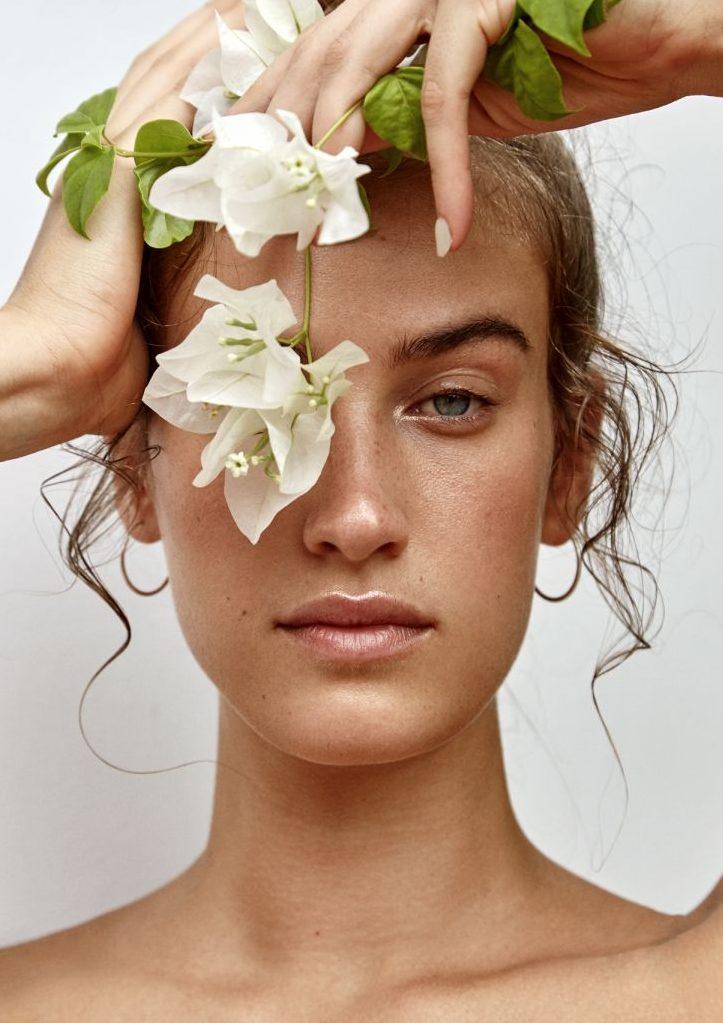 Balistarz-model-Meg-Lindsay-headshot-with-flower-over-eye